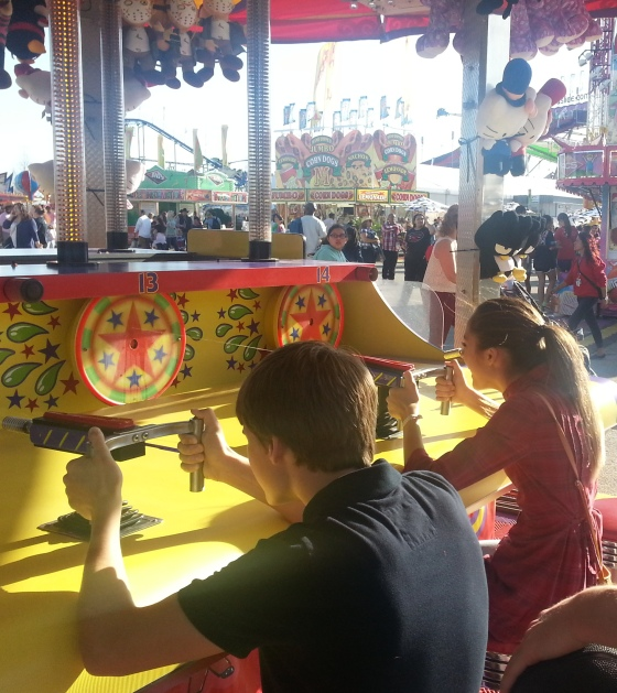 Taylor playing carnival games